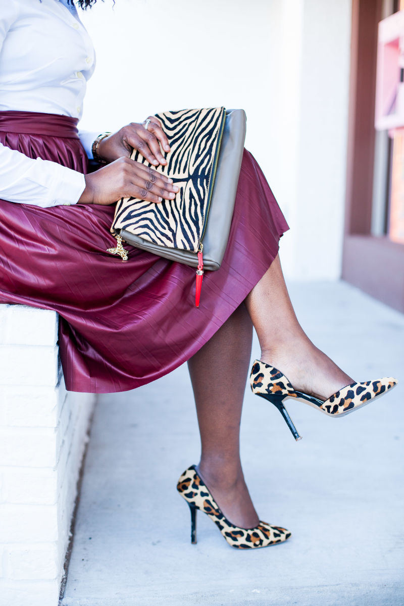 faux leather skirt with animal print details