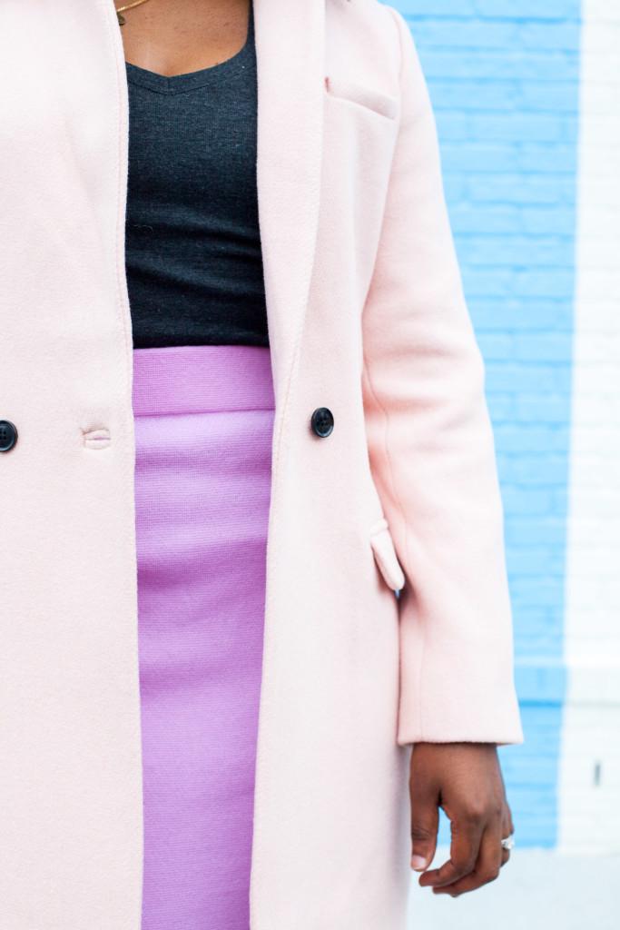 pastel pink skirt and grey shirt