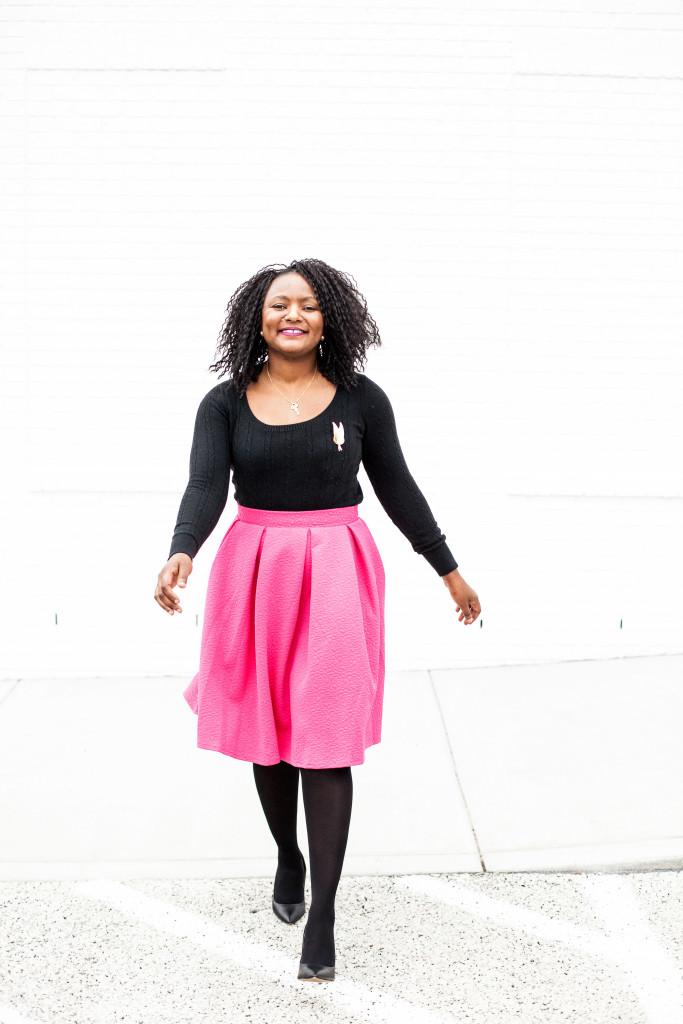 pink midi skirt and black sweater