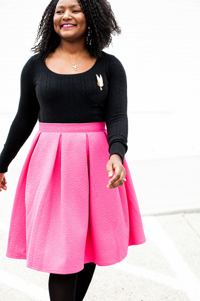 pink midi skirt and black swaeter
