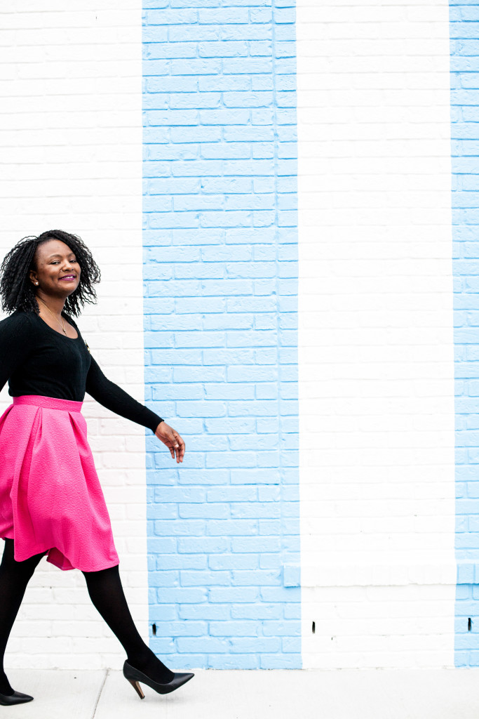 pink midi skirt and black sweater