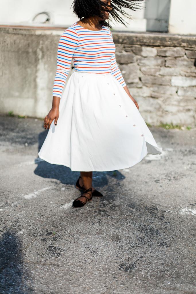 White flared denim skirt