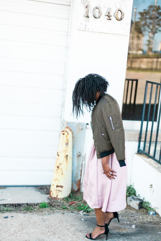 green jacket and feminine skirt